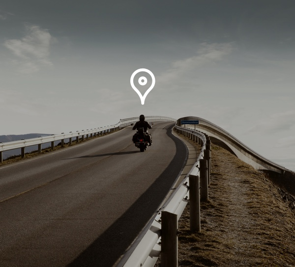 man on motorcycle with map icon above his head